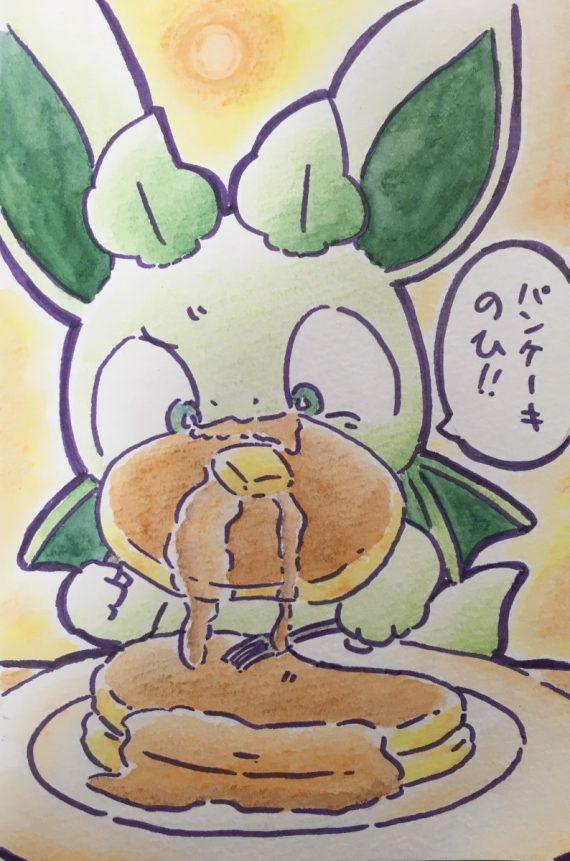 大きいパンケーキを口に咥えるカッシーくん